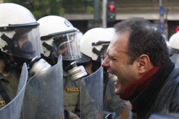 Profile of a Greek riot police officer